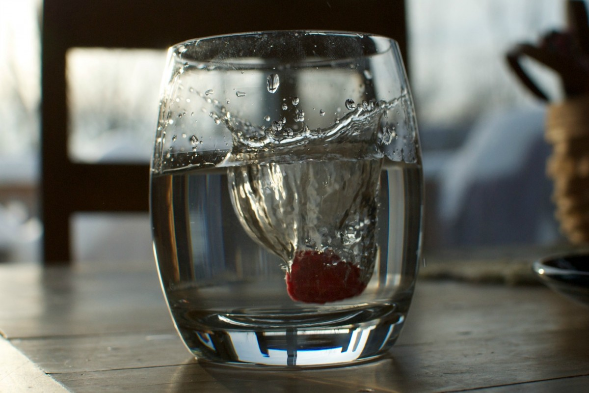 Glass of water with berry in it
