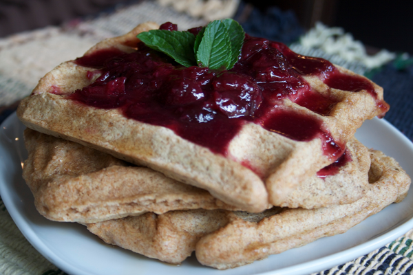 Vegan waffles with cherry sauce