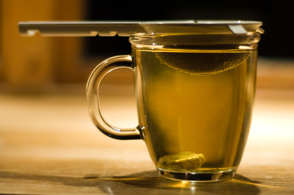 green tea in mug with infuser