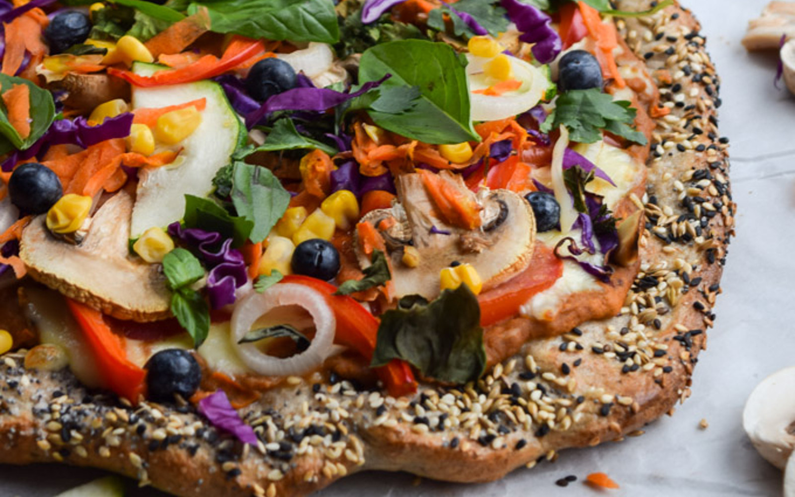 Rainbow Veggie and Hummus Pizza with Everything Bagel Crust