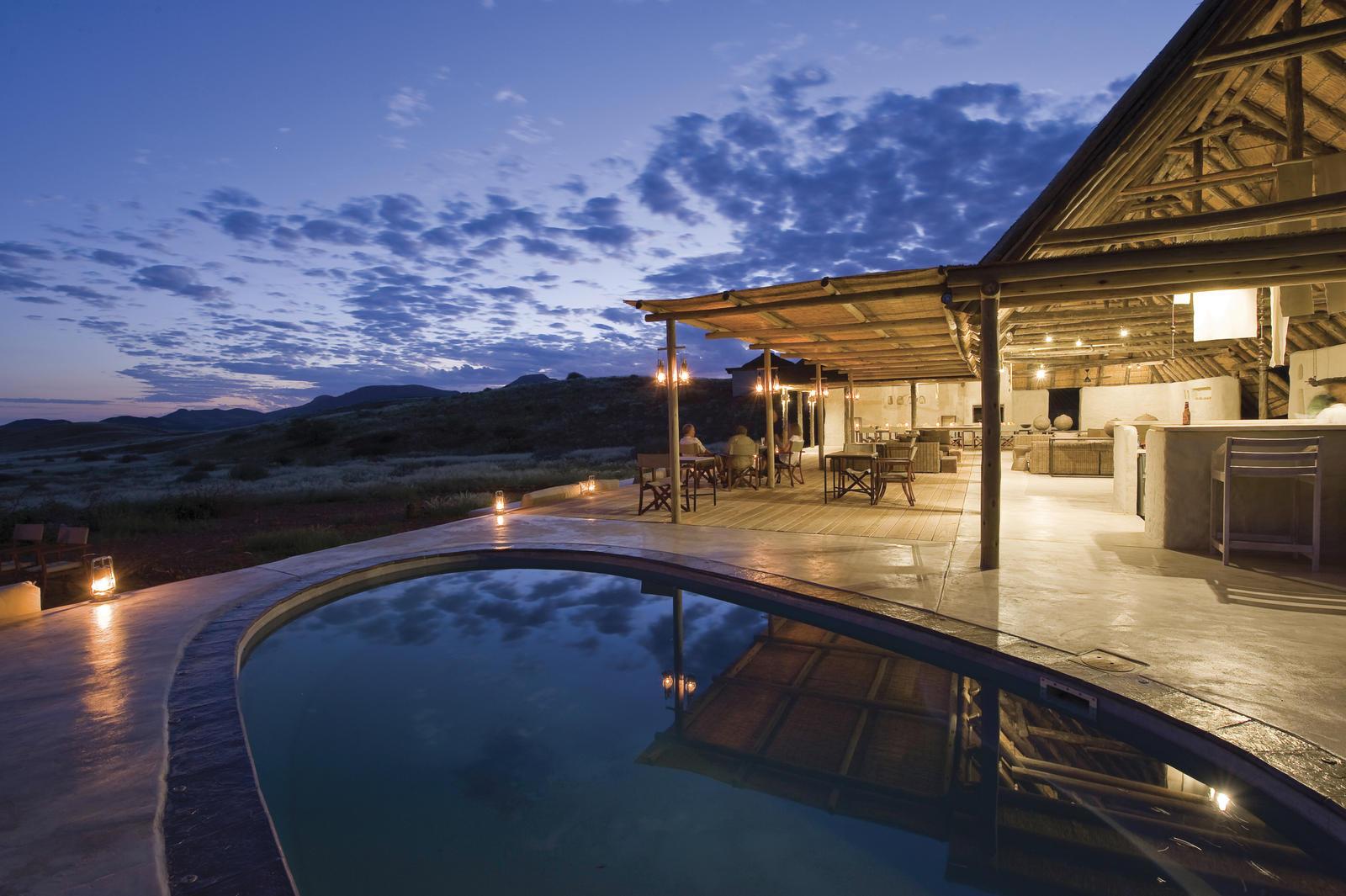 Damaraland_Camp_pool_at_sunset_(c)_Dana_Allen