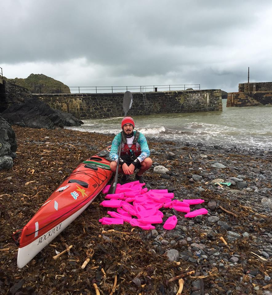 These Images of Hot Pink Bottles Washed Ashore Tell a Bigger Story About Ocean Trash