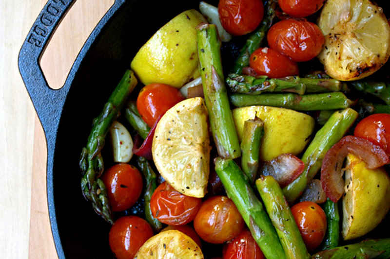 Skillet Filled With Sautéed Asparagus and Tomatoes