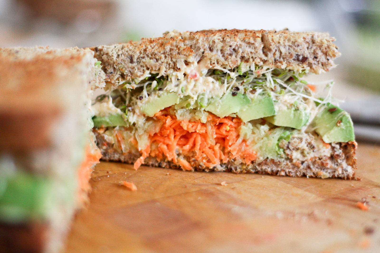 Hummus, Carrot, Cucumber, Avocado, and Sprouts Sandwich
