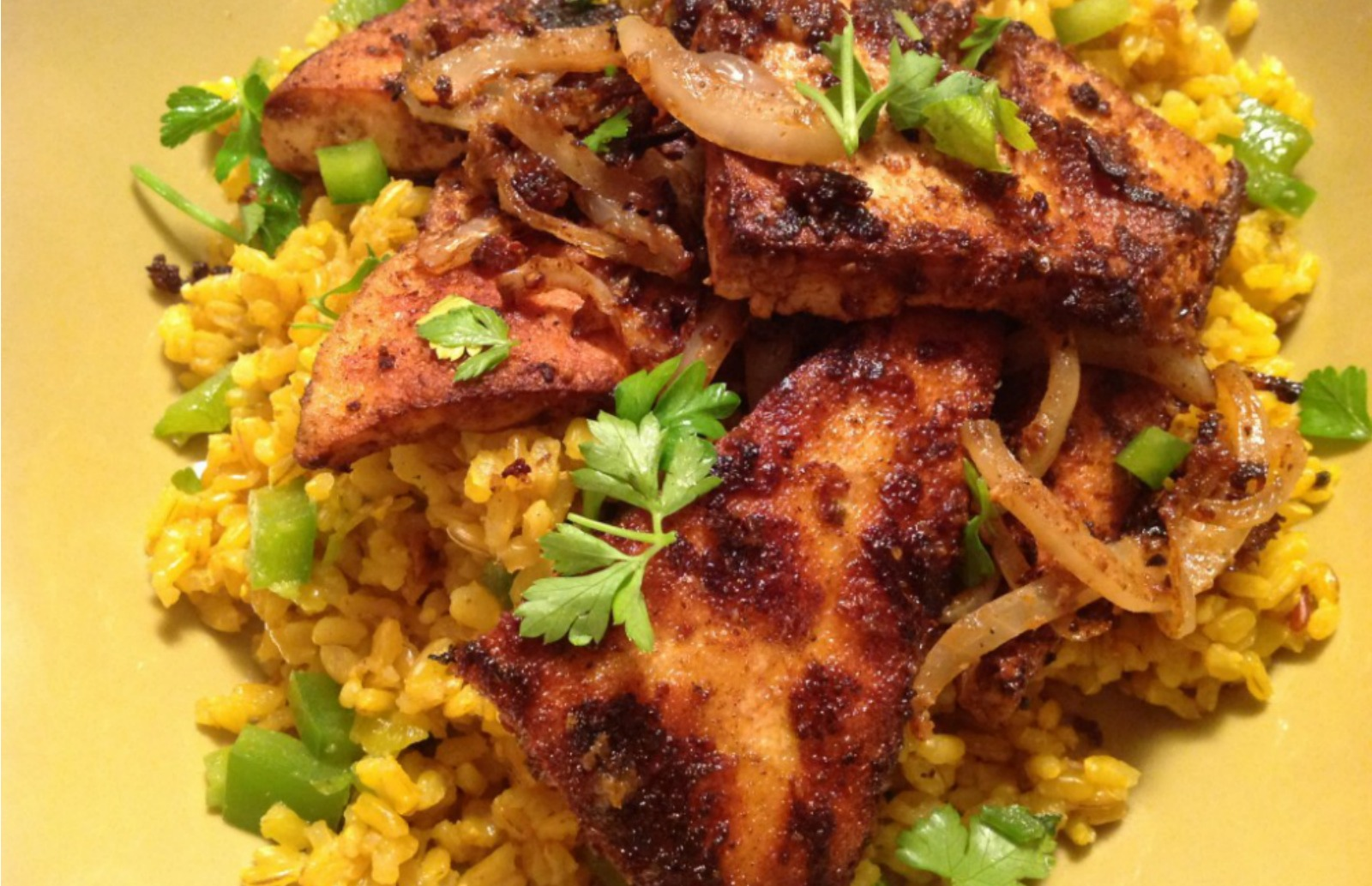 Chile-Rubbed Tofu and Onions over Spanish Rice