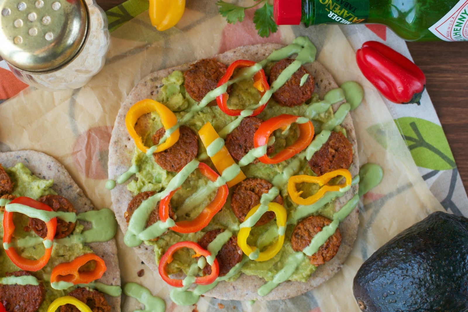 Chipotle Sausage, Peppers, & Guacamole Flatbreads with Cilantro Cream [Vegan]