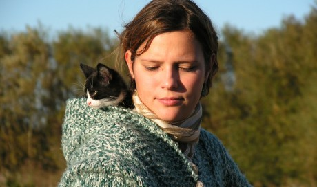person with cat on shoulder