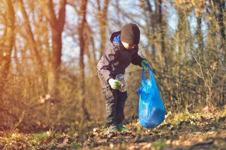 kid picking up trash