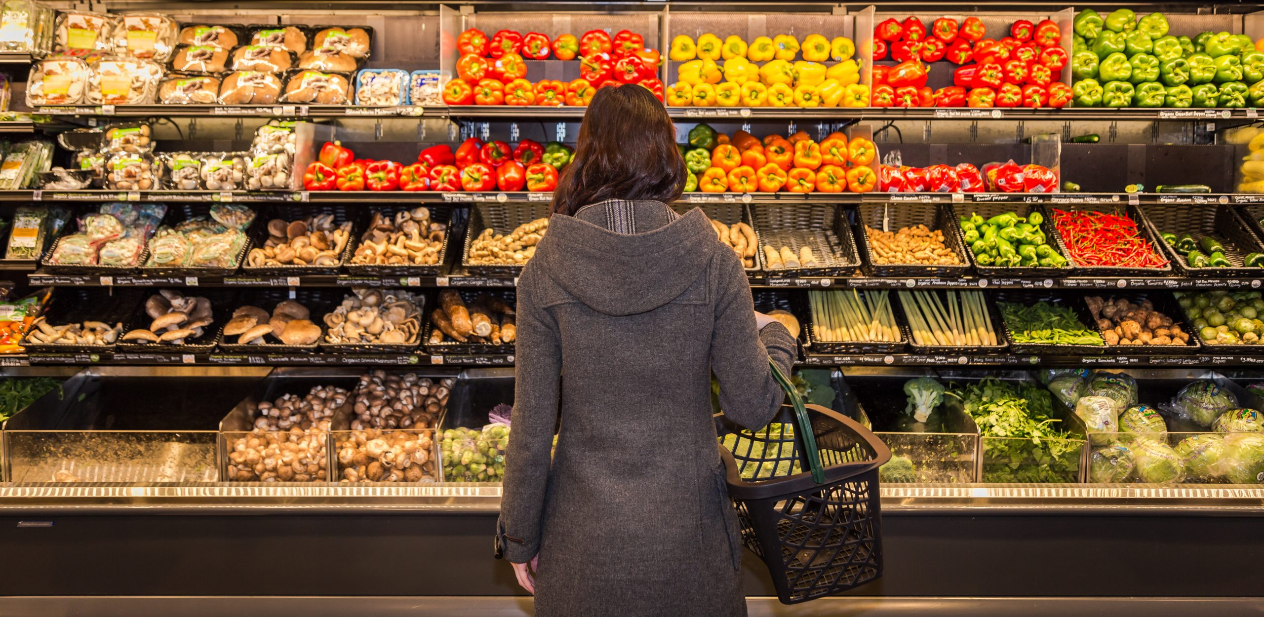 woman in front of produce
