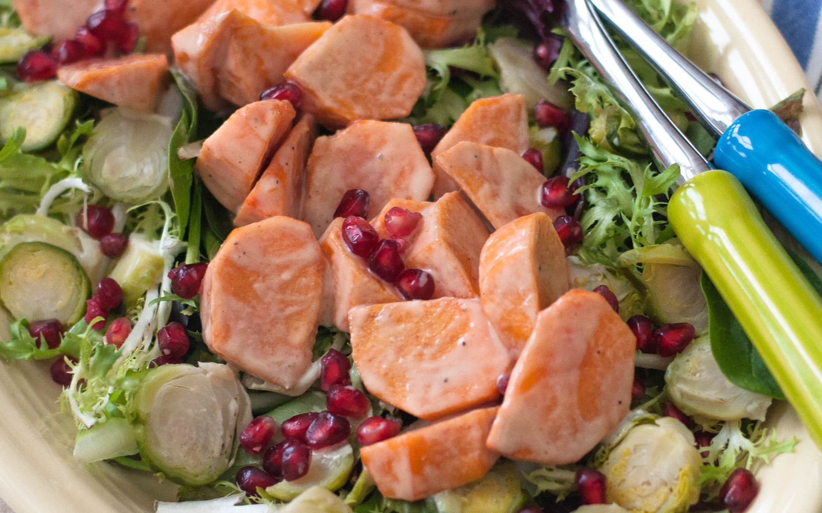 Fresh Winter Salad With Persimmon, Brussels Sprouts, and a Creamy Maple-Tahini Dressing