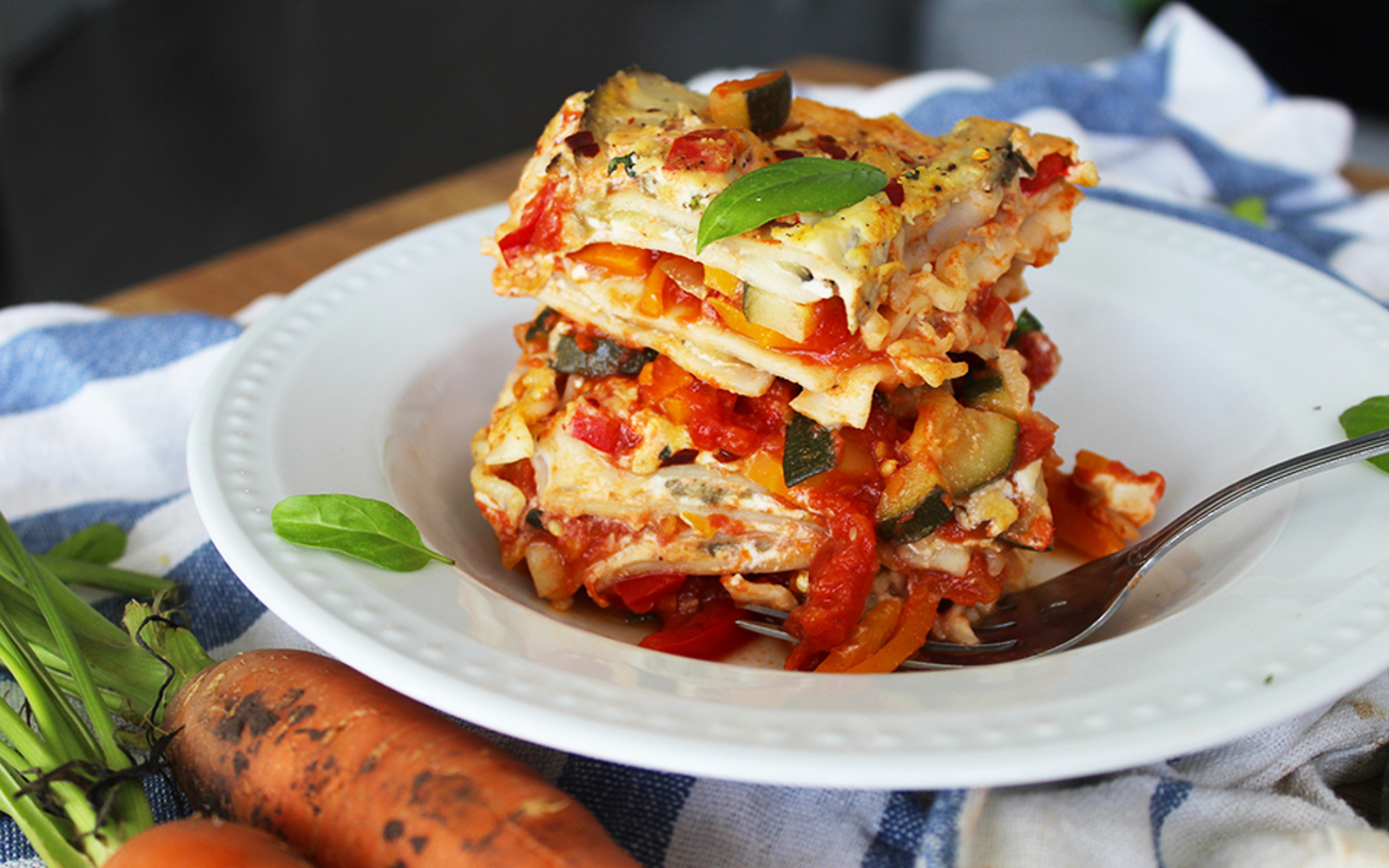 Lasagna With Harvest Vegetable Tomato Sauce and Basil Cashew Cheese