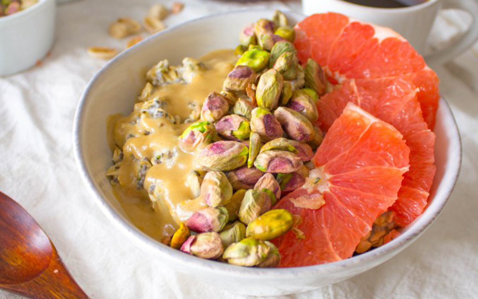 Breakfast Bowl With Oats, Pistachios, Grapefruit, and a Sweet Tahini Drizzle