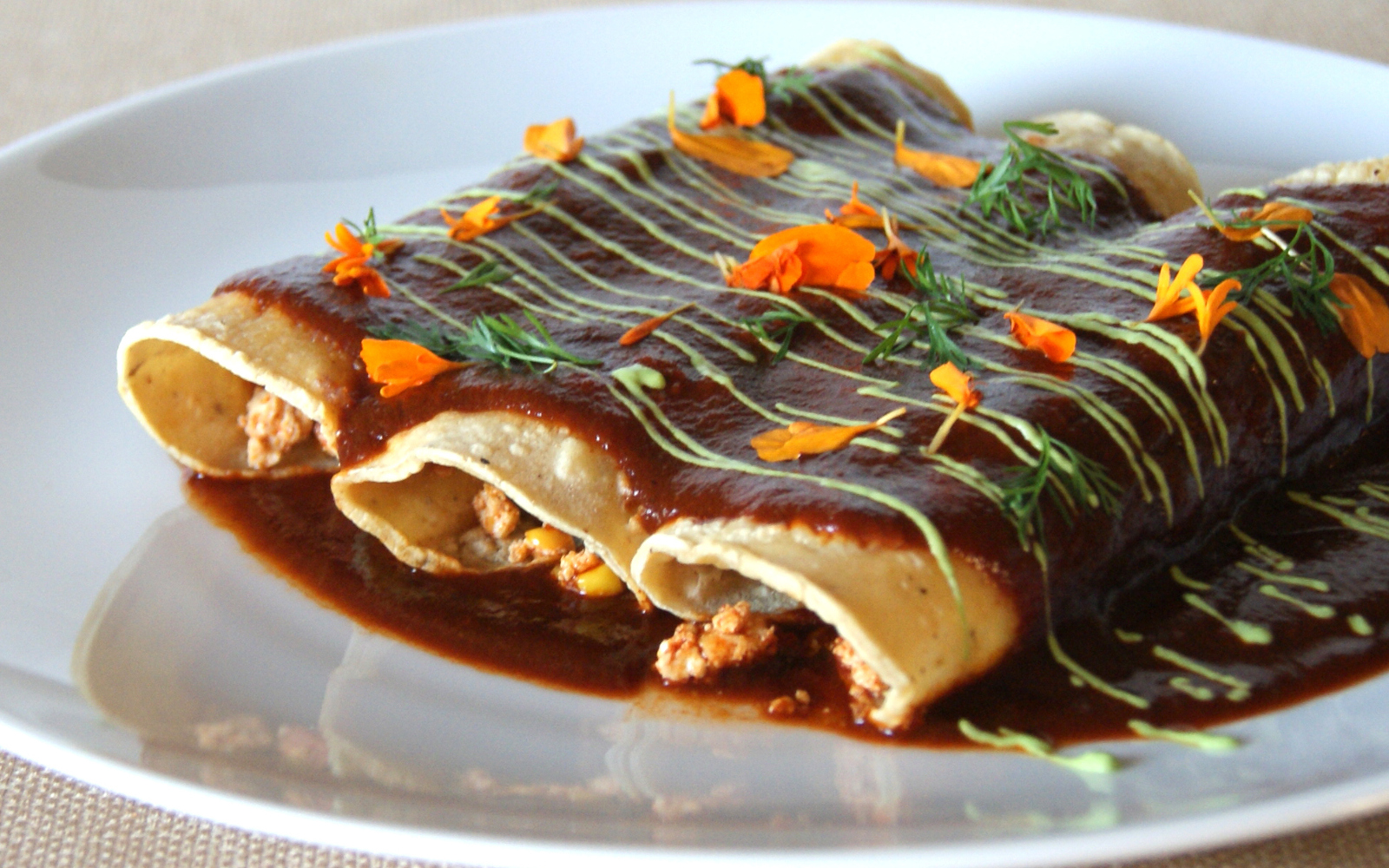 Tofu and Vegetable Enchiladas With Spicy Chili Sauce and Avocado Crema