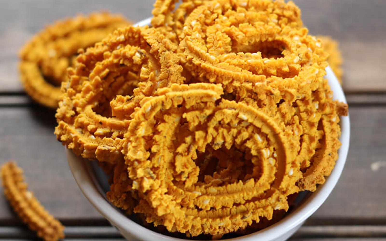 Image result for orange indian snacks