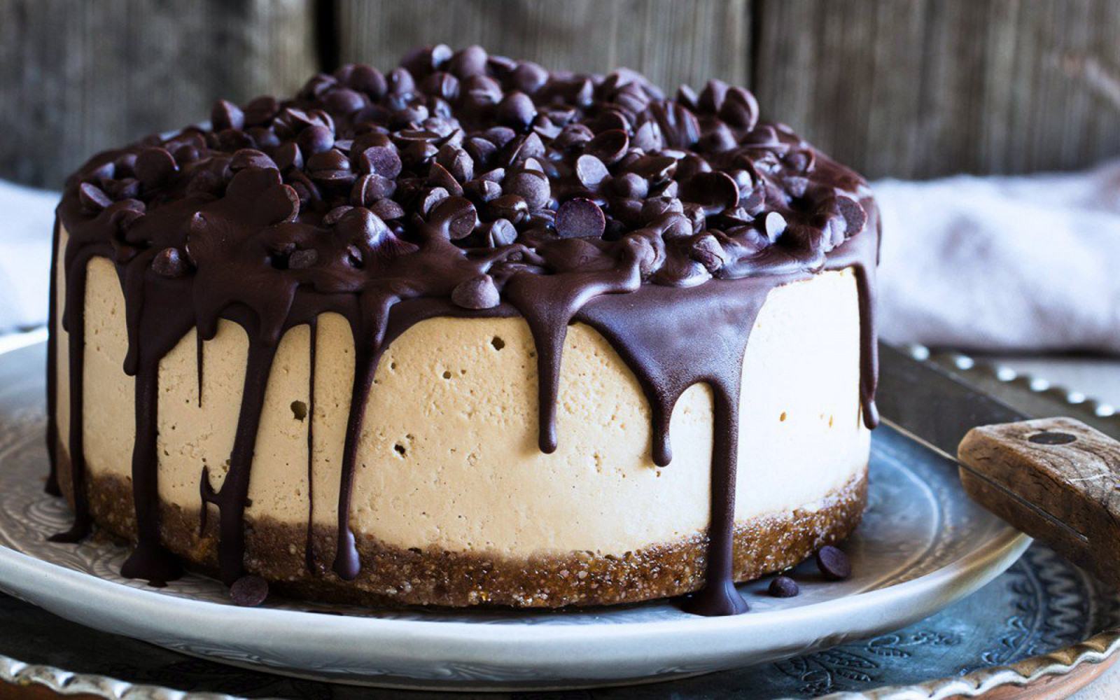 Vegan mocha cheesecake covered in chocolate chips