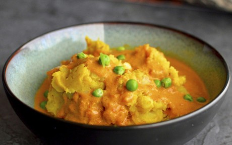 Indian golden mashed potatoes with curried gravy