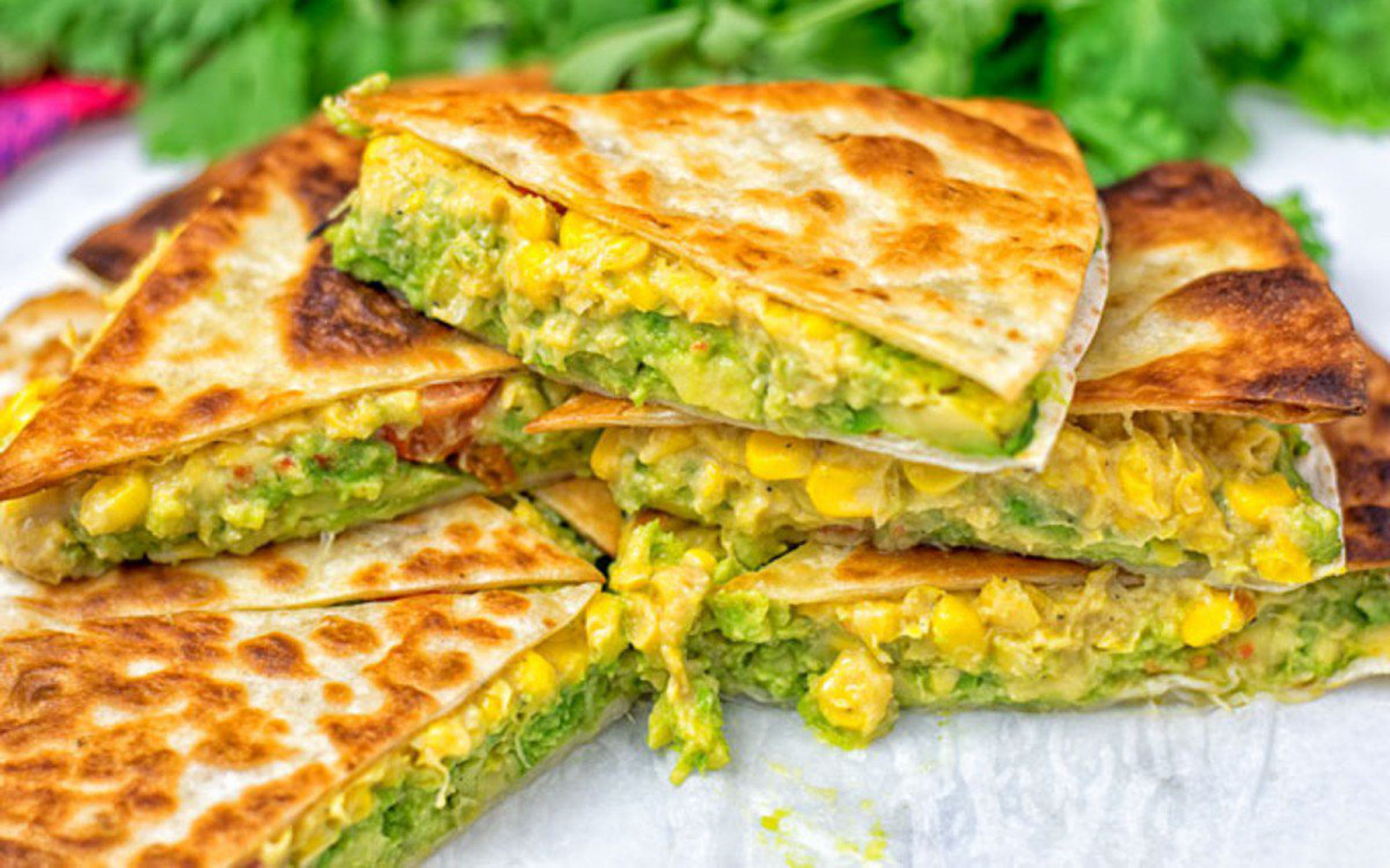 cheesy corn and smashed avocado quesadillas
