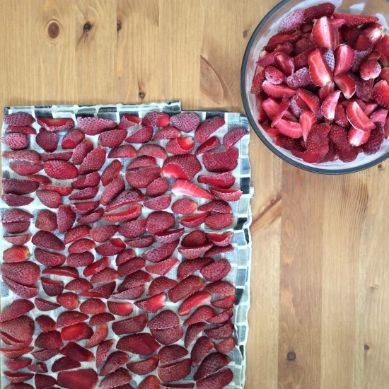 Preparing-Strawberries-for-the-Freezer-550x550