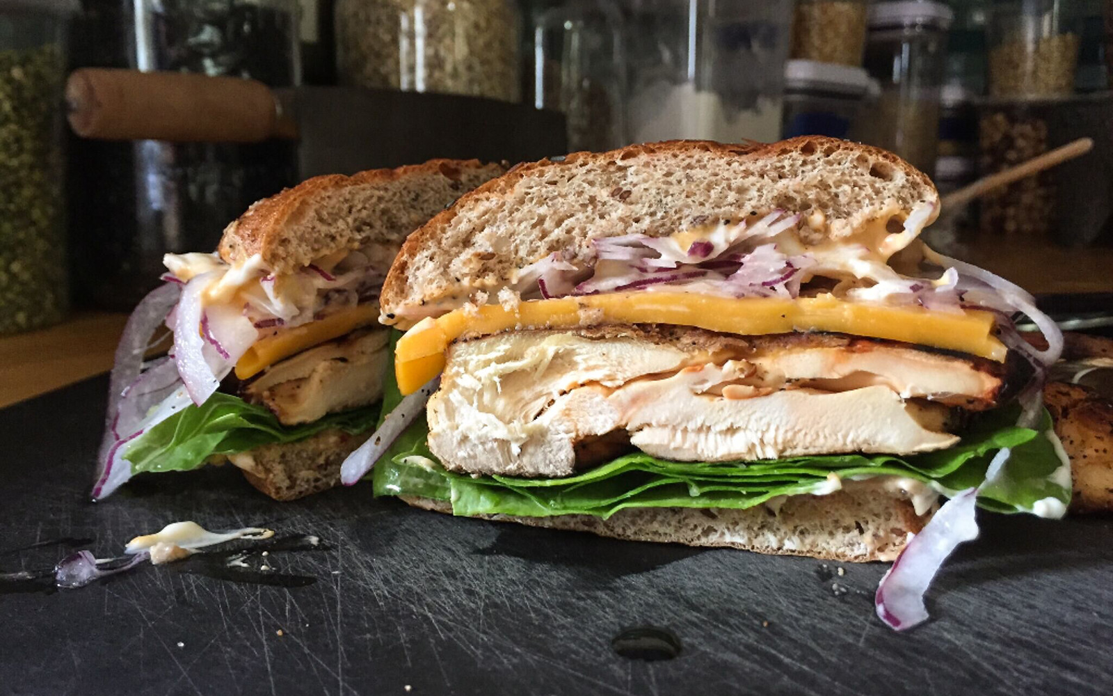 Vegan grilled chicken of the woods sandwich cut in half