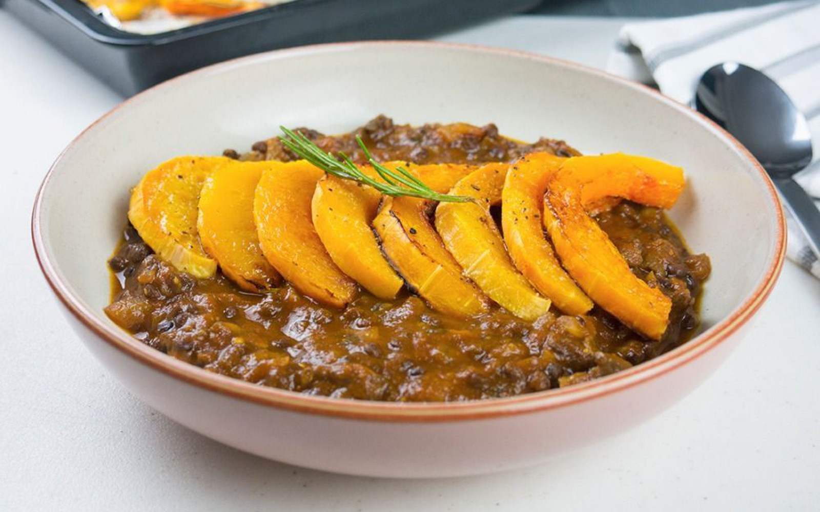 Rosemary Roasted Butternut Squash With Lentil, Tomato, and Mushroom Sauce