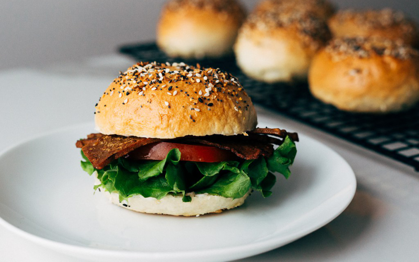 Vegan homemade everything bagel BLT with tofu bacon