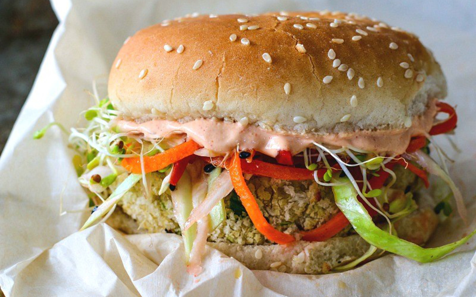 White Bean Burger With Sesame Ginger Slaw With a Gochujang Yogurt Spread