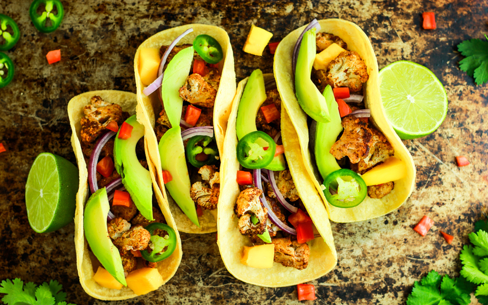 Vegan Gluten-Free Jerk Cauliflower Tacos with peppers lime and tortillas