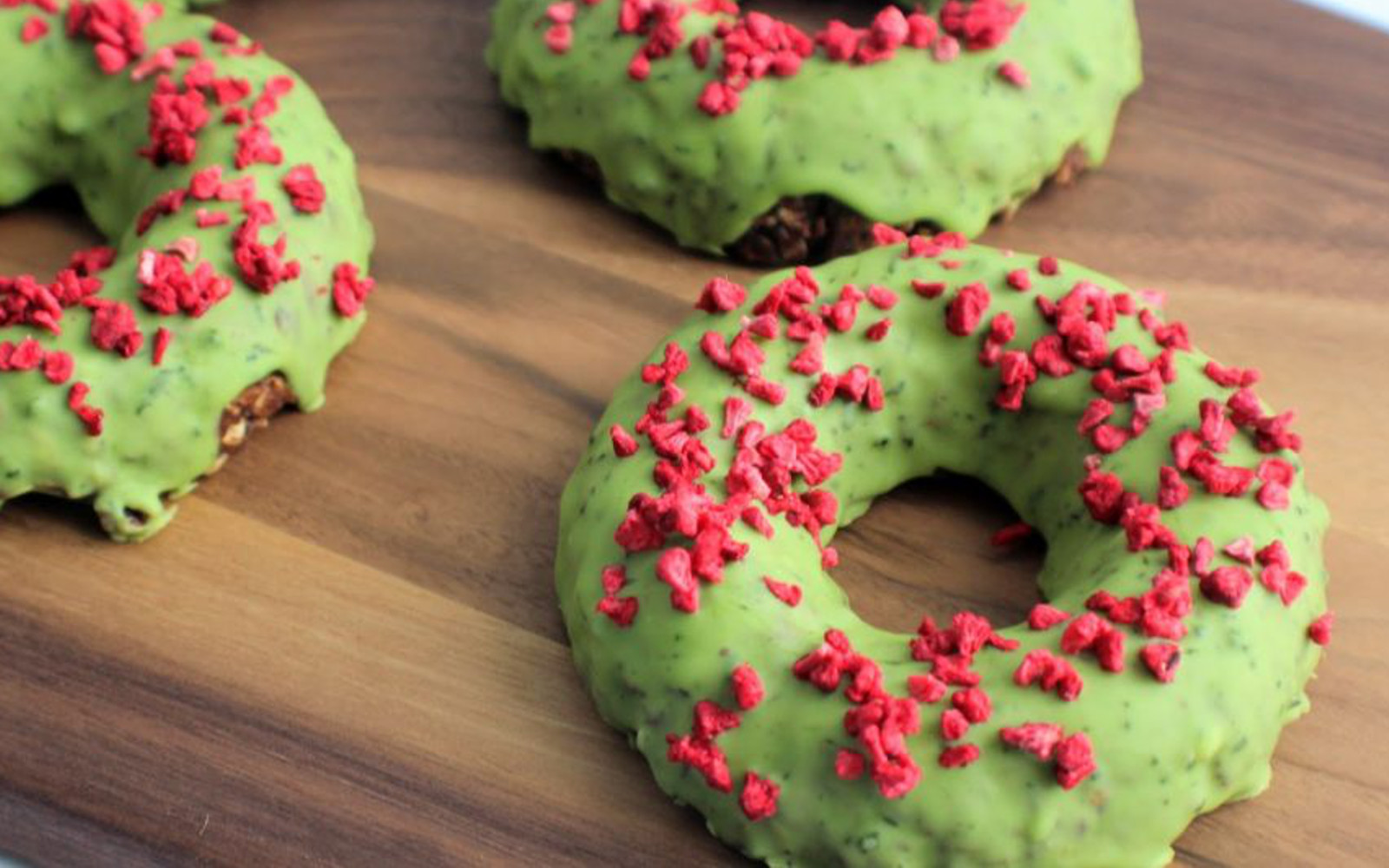 Vegan Gluten-Free Raw Chocolate Doughnuts With White Chocolate Matcha Glaze with red sprinkles