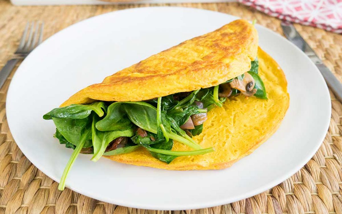 Chickpea flour omelet With Sun-Dried Tomatoes, Mushroom, and Spinach Filling