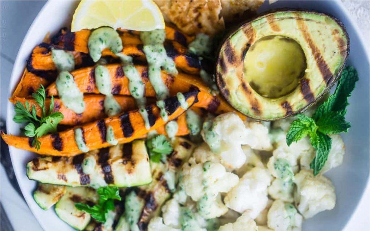 Grilled Avocado, Cauliflower, and Sweet Potato Power Bowl With Tahini Dressing