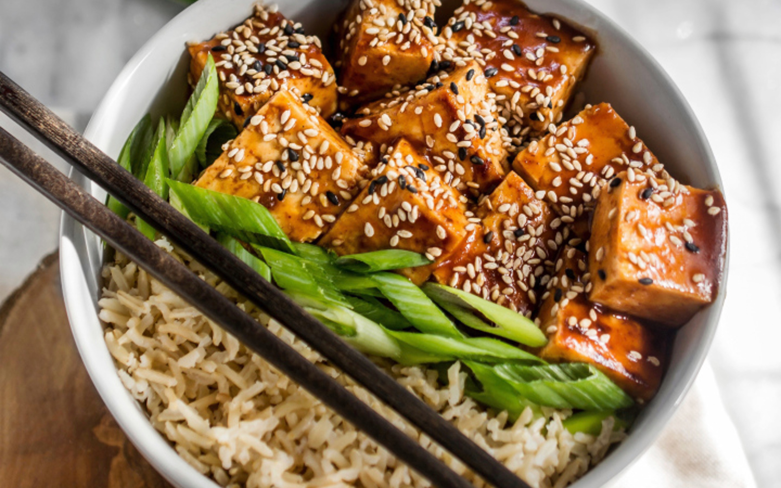Vegan Sweet and Sour Sesame Tofu Bowl with scallions