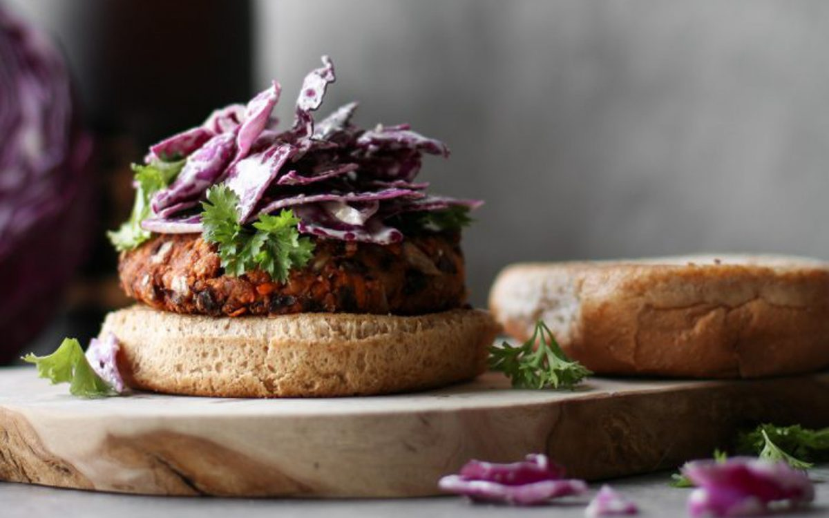 Vegan black bean burger with tahini slaw
