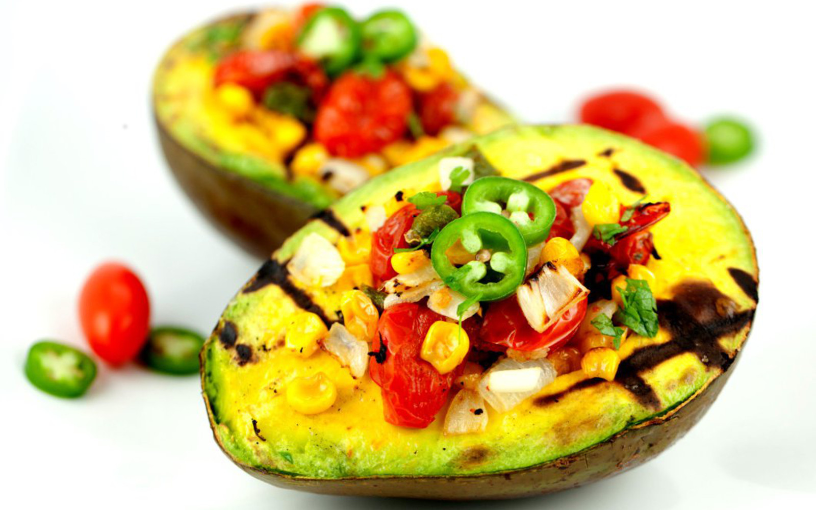 Grilled avocado with roasted tomatoes