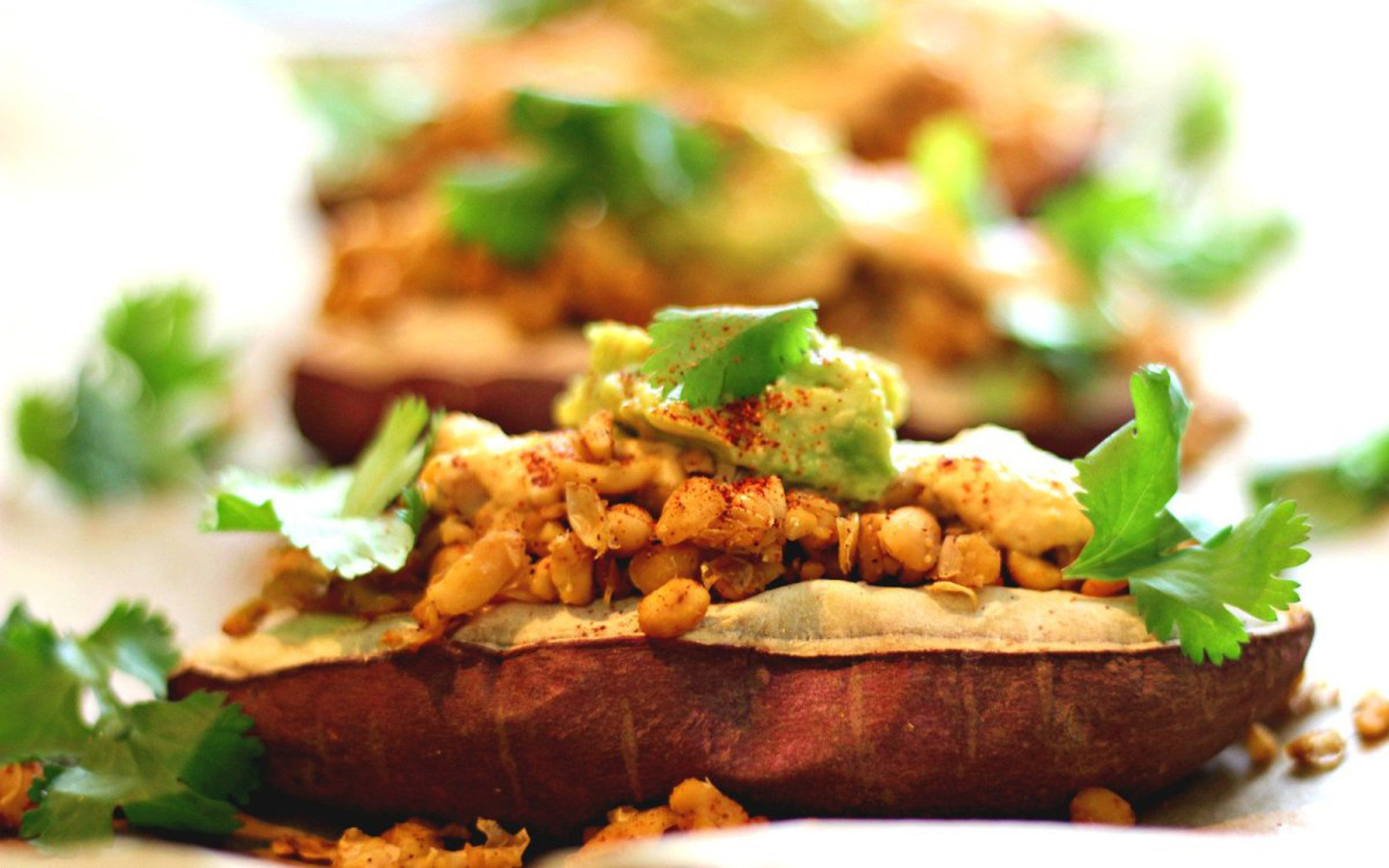 Loaded Baked Sweet Potatoes with vegan bacon