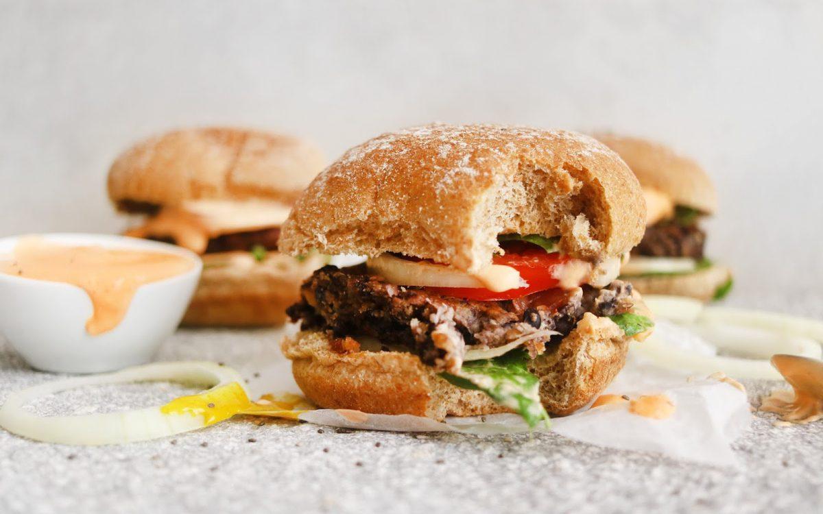 vegan black bean burgers with the best burger sauce
