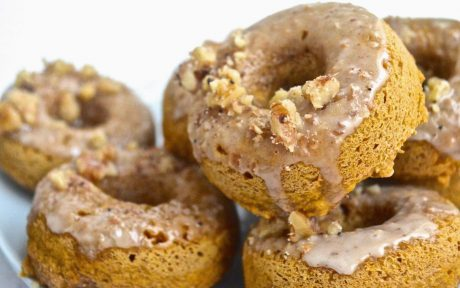 Vegan Pumpkin Spice Doughnuts With Maple Glaze in a pile