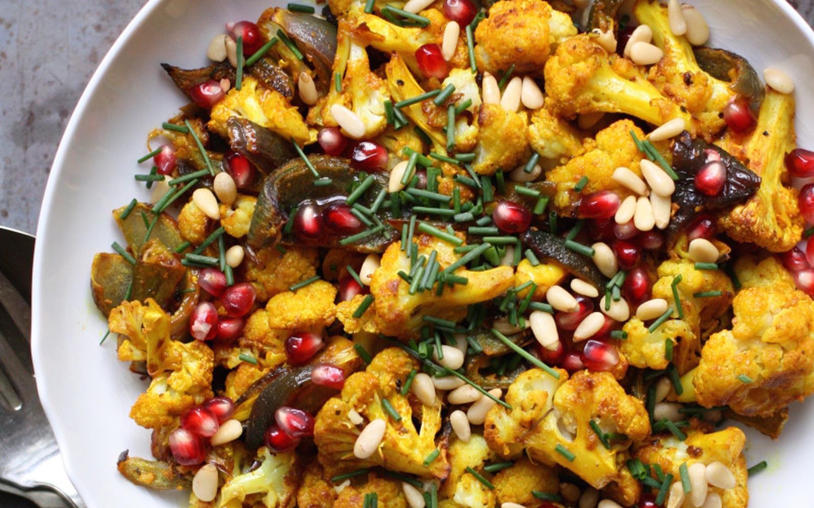 Vegan Grain-Free Turmeric-Roasted Cauliflower With Maple-Pomegranate Vinaigrette