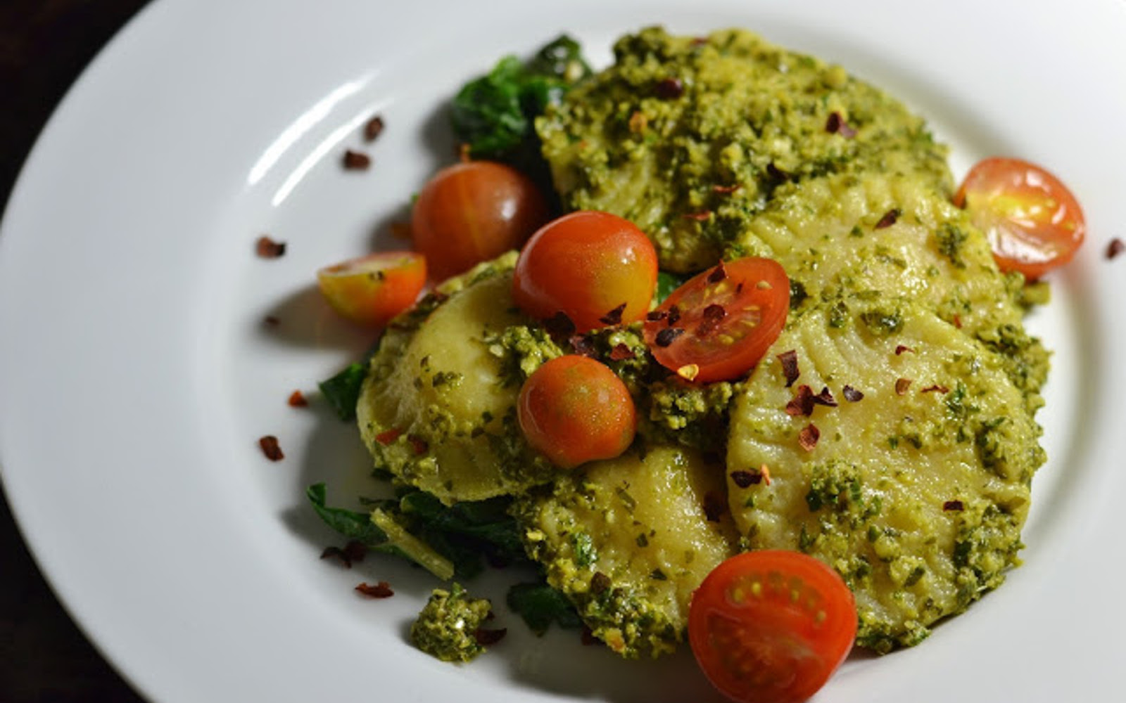 Vegan Ravioli With Kale Pesto And Sautéed Chard and fresh tomatoes