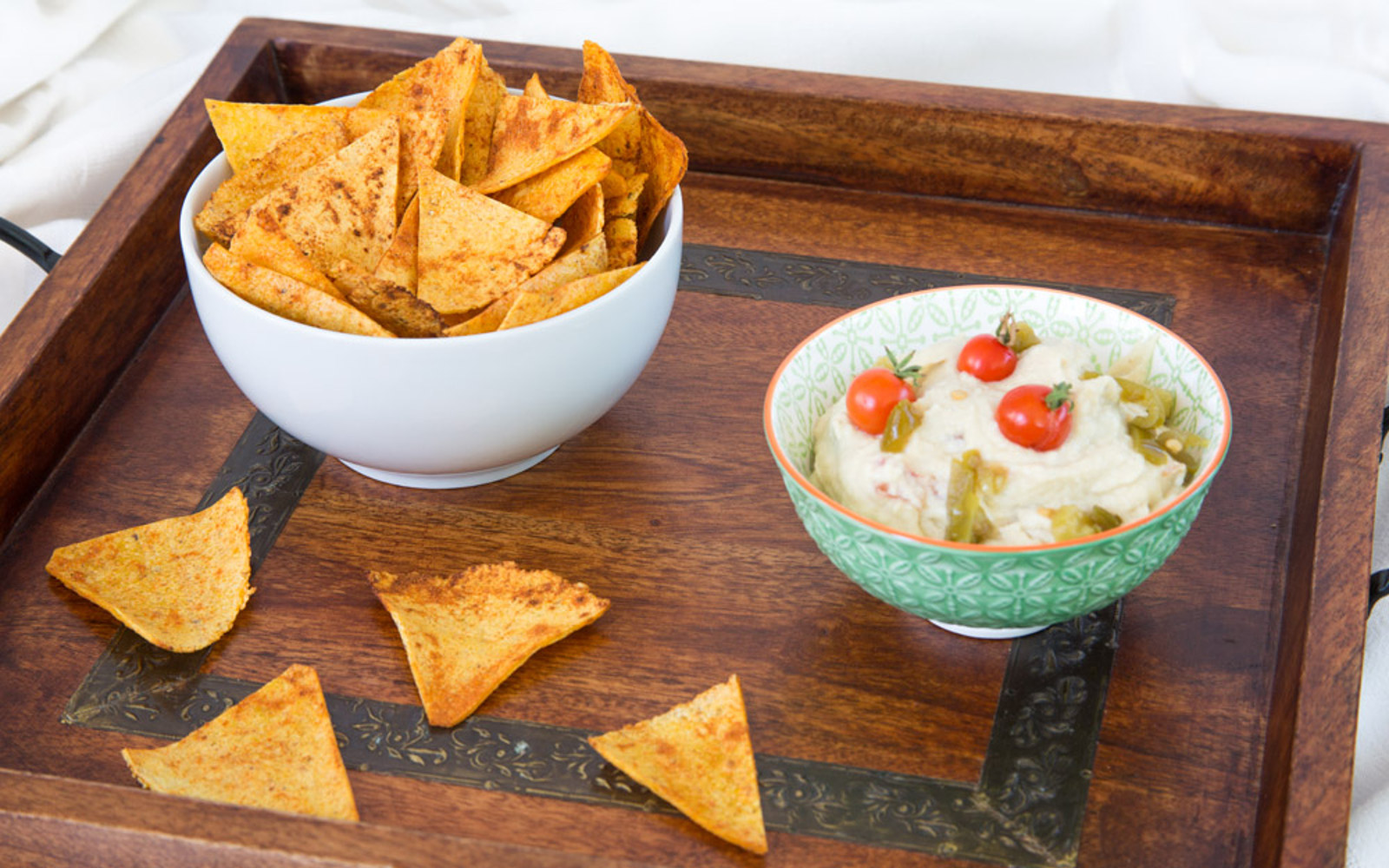 Vegan Gluten-Free Oil-Free Chili Lime Spiked Corn Chips in a dipping sauce