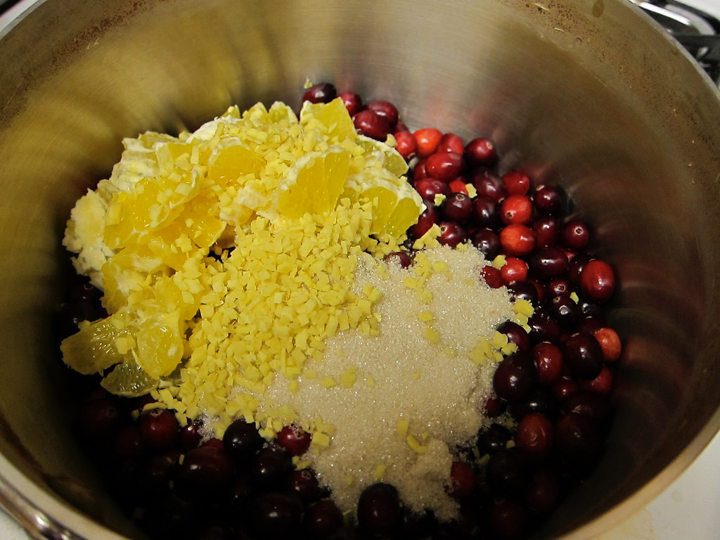 cranberries in a pot with sugar and lemon