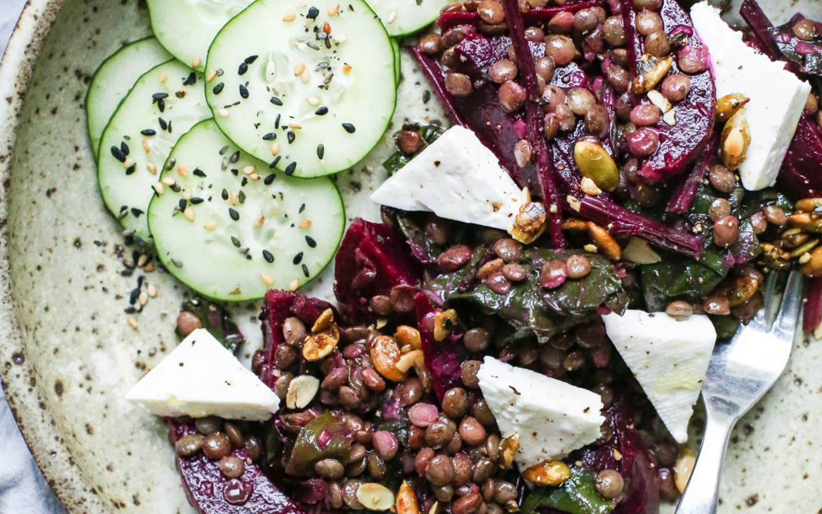 Vegan Beet and Lentil Salad With Beet Greens Topped With Vegan Cheese