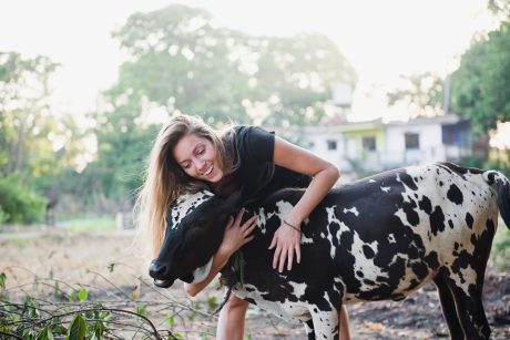 girl hugs cow