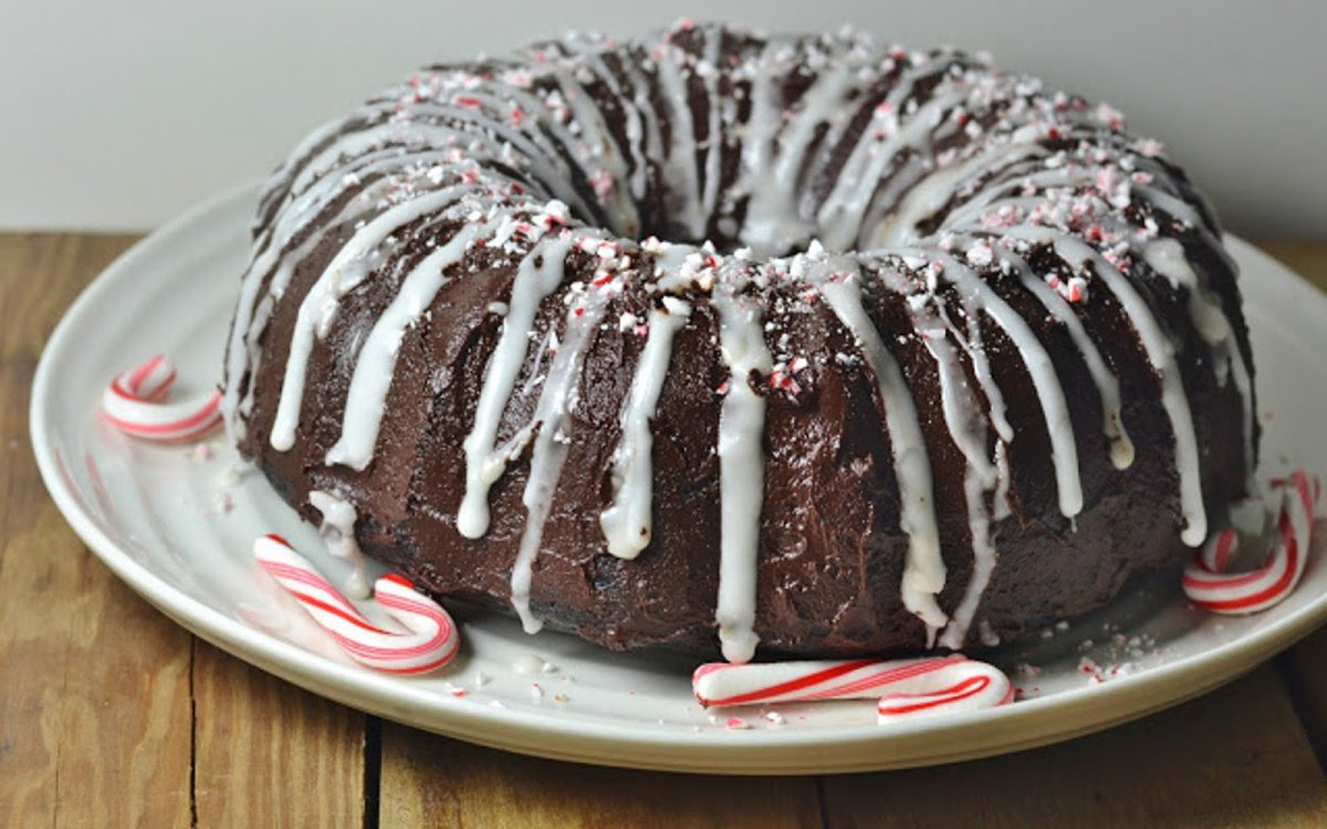 Vegan Triple Chocolate Peppermint Bundt Cake with candy cane topping and glaze