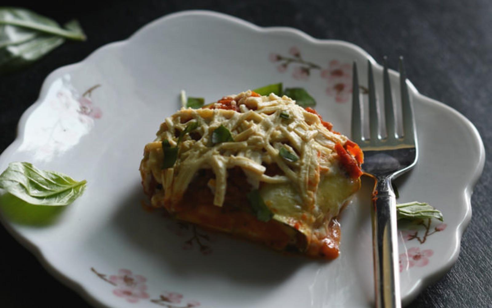vegan gluten-free zucchini ravioli topped with dairy-free cheese