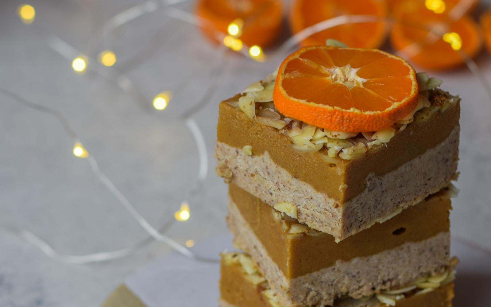 Vanilla Orange Pumpkin Bars topped with almonds and orange