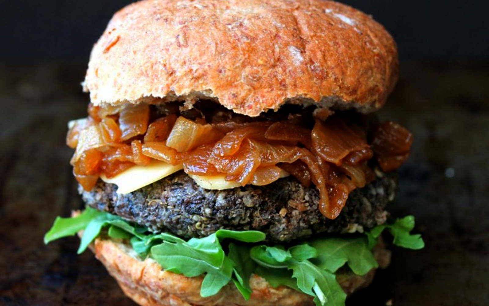 Pan-Seared Mushroom Burgers With Caramelized Onions and Arugula