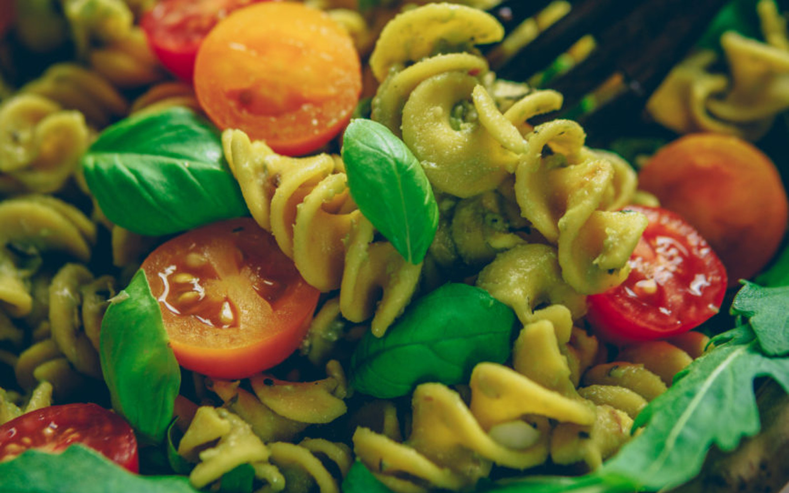 Vegan, Gluten-Free, Oil-Free Avocado Pesto Pasta with arugula and cherry tomatoes