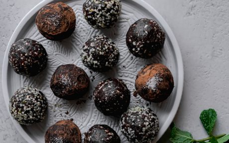 Coconut Carob Cashew Bliss Bites [Vegan, Gluten-Free] with various toppings and coatings