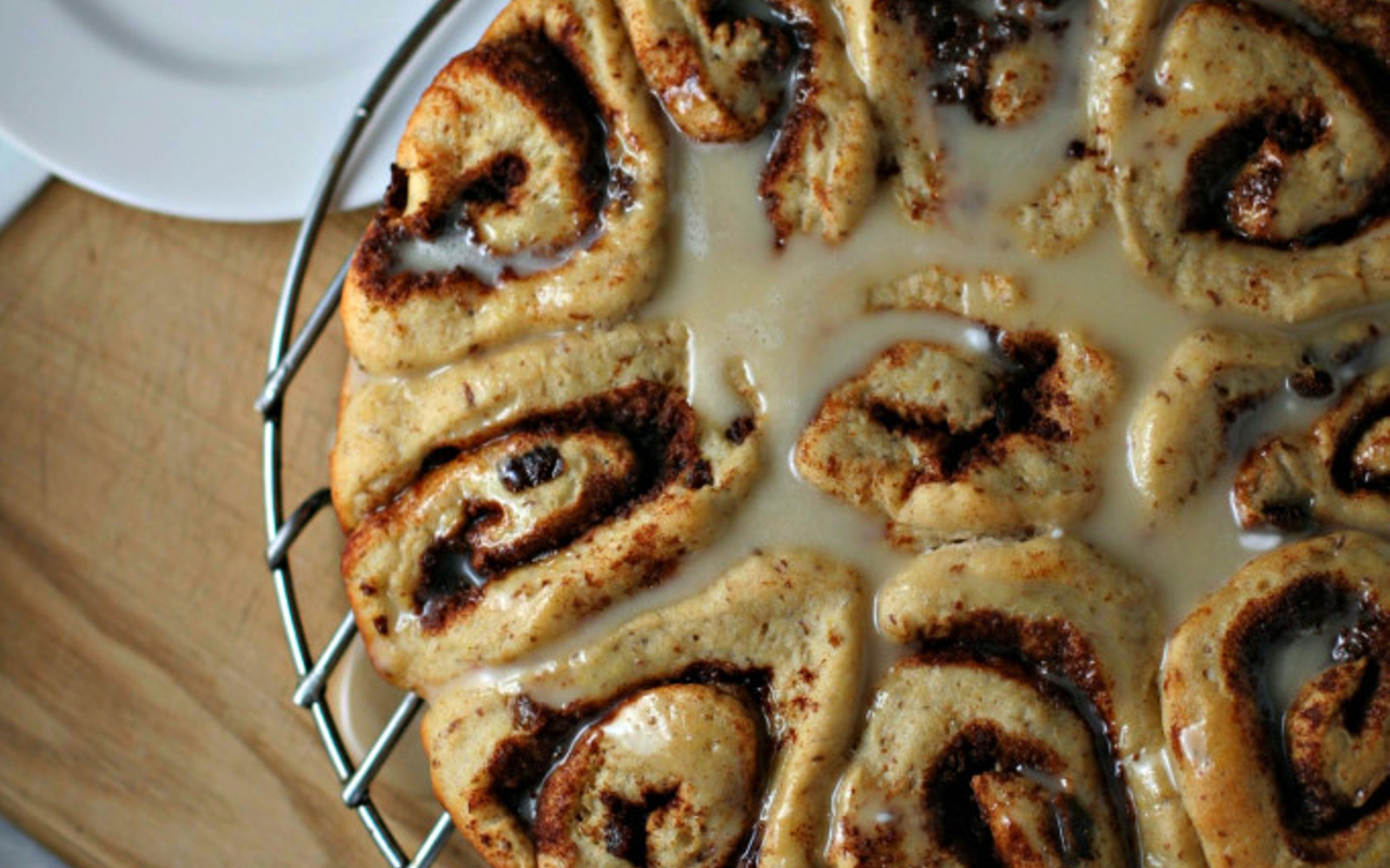 Vegan Maple Glazed Cinnamon Raisins Rolls close up with icing