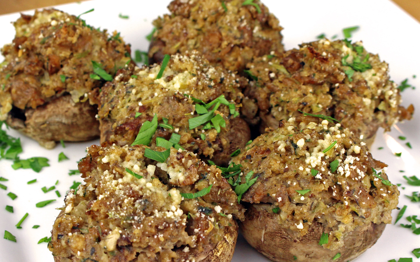 Vegan Sausage Stuffed Mushrooms topped with herbs and spices